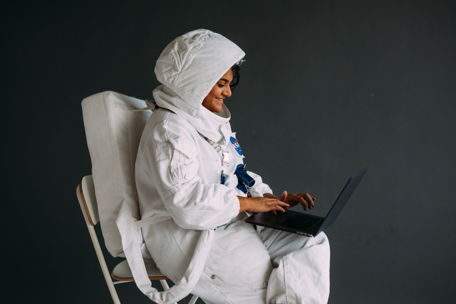 astronaut playing on laptop